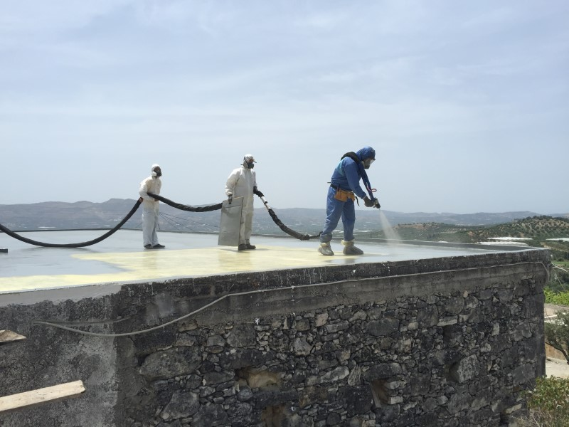 Spraying polyurea coating on a roof